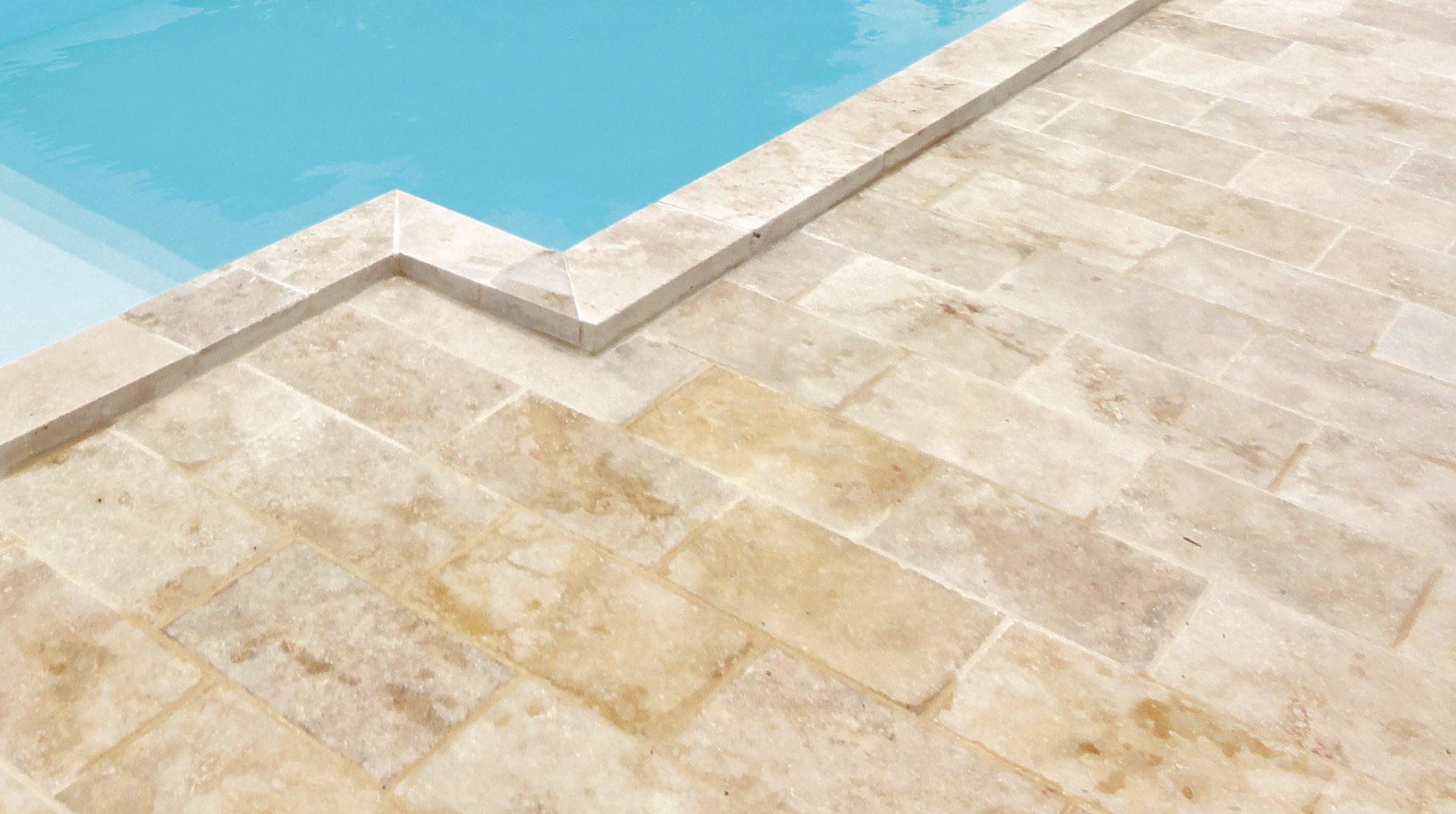 pierre-taillee Comment choisir le revêtement autour de sa piscine ?